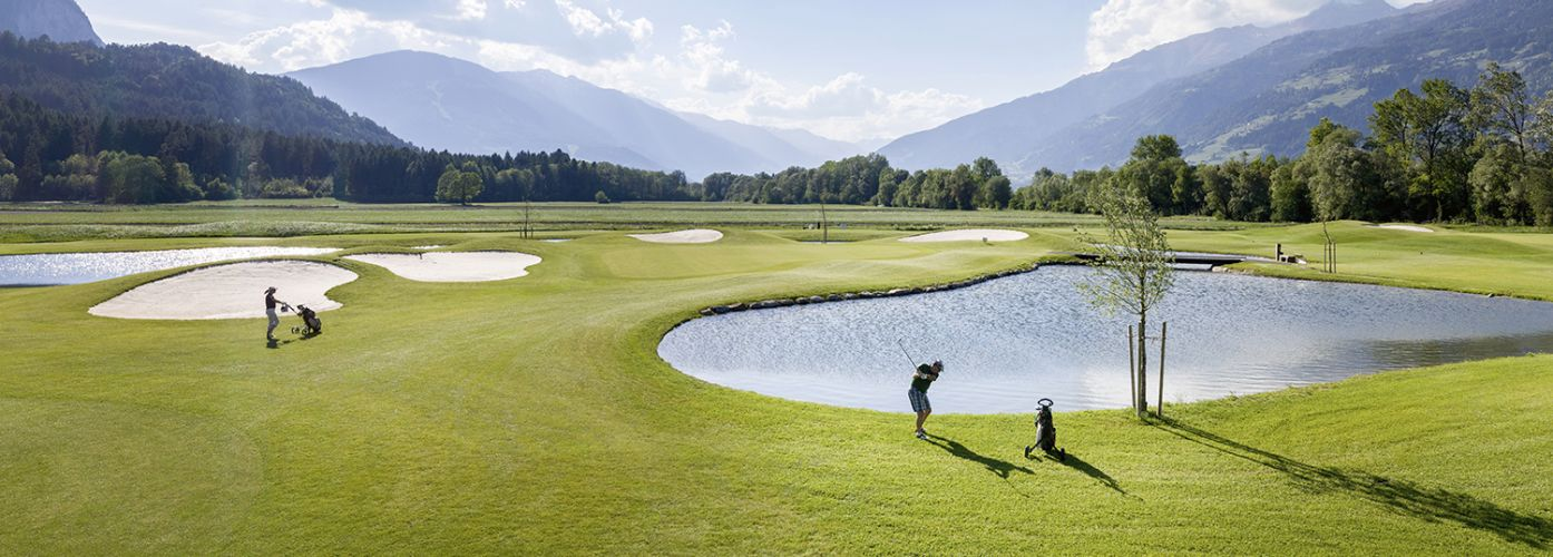 Golf course lake South Tyrol beautiful weather